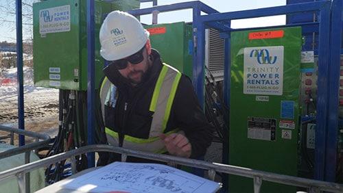Generator technician reviewing installation plans.