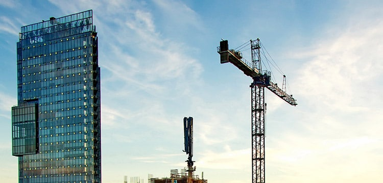 High-rise building and the crane