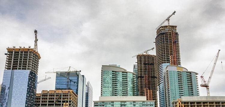 High rise buildings and cloudy sky